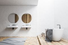 White hotel bathroom interior. White wall bathroom interior with a white tub, a double sink and two round mirrors. 3d rendering mock up Royalty Free Stock Image