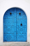 White Wall With Blue Door Royalty Free Stock Images