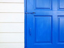 White Wall With Blue Door Stock Photo