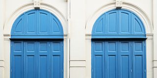 White wall and blue doors. Close up white wall and blue doors stock photography