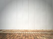 White wall and brick floor Royalty Free Stock Photo