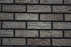 white wall of bricks with a gray tint brick background stock photos