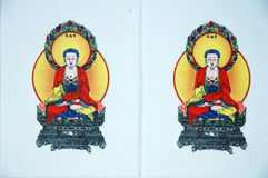 White wall with buddha Stock Photo