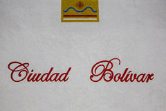 White wall with Ciudad Bolivar words and logo of the city. Venez Stock Image