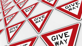 White Wall Covered in Neat Give Way Signs Array Royalty Free Stock Photos