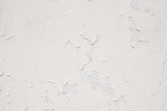 White wall with cracked plaster Stock Photo