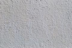 White wall with cracks, mosaic pattern. White wall with cracks old paint, mosaic roughness lime putty whitewash. Background, old, texture, graphics, vintage Royalty Free Stock Photography