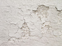 White wall with cracks Stock Images