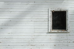 White Wall With Dark Window Royalty Free Stock Images