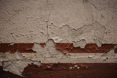 white wall, detail of an abandoned and crumbling wall red stripe stock images