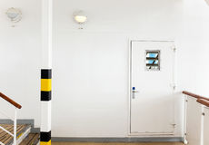 White wall with door Stock Images