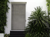 White wall entrance with garden Stock Image