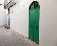 White wall and green door. Medina, Tangier, Morocco Royalty Free Stock Images