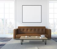 White wall living room, brown sofa, poster. White wall living room interior with a soft brown sofa, a coffee table and a framed poster on the wall. 3d rendering Royalty Free Stock Photography