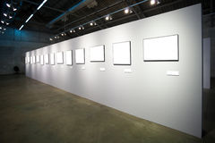 White wall with many empty frames Royalty Free Stock Photography