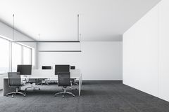 White wall modern company office, computers. Office waiting room or canteen area with a concrete floor, large windows, round tables, black chairs and a sofa Royalty Free Stock Photos