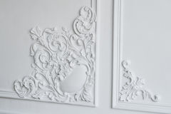 White wall molding with geometric shape and vanishing point. Luxury white wall design bas-relief with stucco mouldings Royalty Free Stock Photography