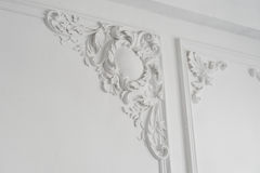 White wall molding with geometric shape and vanishing point. Luxury white wall design bas-relief with stucco mouldings Royalty Free Stock Image