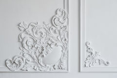White wall molding with geometric shape and vanishing point. Luxury white wall design bas-relief with stucco mouldings. Roccoco element royalty free stock images