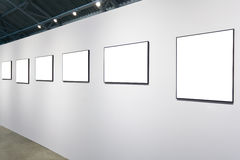 White wall in museum with frames Stock Image