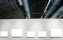 White wall in museum with frames Royalty Free Stock Image