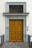 White wall and new yellow wooden door Stock Photos