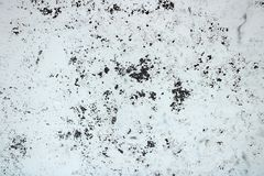 White wall with old peeling paint royalty free stock photography