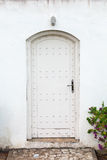 White wall and old wooden door Stock Photo