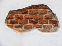 White wall with orange bricks Stock Photos