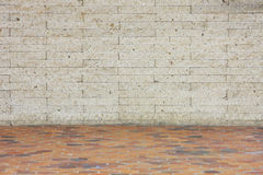 White wall and orange floor. White stone wall and orange tile floor, in horizon royalty free stock images