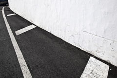 White wall with part of street Royalty Free Stock Photo