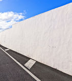 White wall with part of street Stock Images