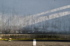 White wall with peinture texture in a parking lot stock image