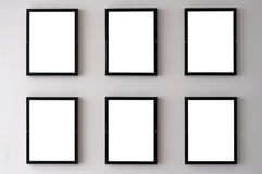 White Wall Picture Frames. Six blank picture frames hanging on a white wall Royalty Free Stock Photography