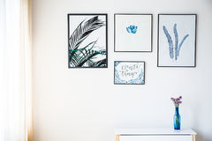 White wall with pictures. With plant motif stock photography