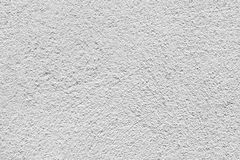 White wall with relief plaster, seamless background Stock Images