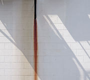 White Wall with Rust Streak and Shadow. stock photography