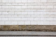 White wall and sidewalk. Beautiful abstract urban background Stock Image