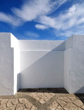 White wall and sky. White Painted Wall on a Sunny day royalty free stock photos