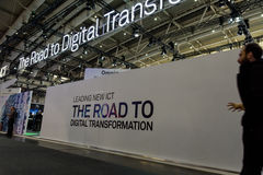 White wall with slogan about digital transformation at CeBIT2017. Hannover, Germany - March 22, 2017: White wall with a slogan about the digital transformation Royalty Free Stock Image