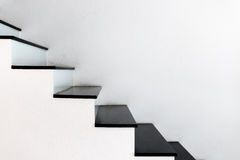 White wall stairs black step Stock Photography