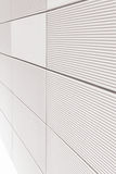 White wall with striped tiles Royalty Free Stock Photo