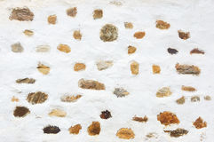 White wall texture with rustic stones Royalty Free Stock Images