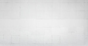 White wall with tiling. Background texture Stock Photo