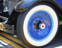 White Wall Tire. With blue hubcap seen at car show Stock Photography