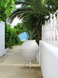 White wall and vase, the way to the beach stock image