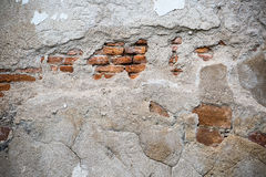 White wall which cracked until see the orange brick inside Royalty Free Stock Photography