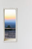 White wall window with sunset mountain view. Stock Photos
