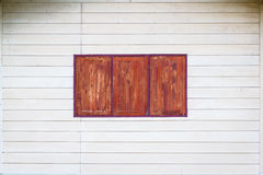 White wall and wood windows. The white wall and wood windows, background Royalty Free Stock Images