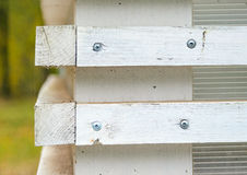 White wall with wooden blinds with horizontal bars Royalty Free Stock Images